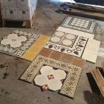 historic tile reproductions spread out on the warehouse floor